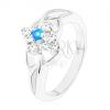 Csillogó gyűrű szétválasztott szárakkal, kék cirkónia átlátszó szegélyben