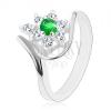 Csillogó gyűrű ezüst színben, sötétzöld virág átlátszó szirmokkal