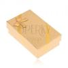 Dobozka fülbevalóra vagy gyűrűre, arany színű anyag kinézetű, masni