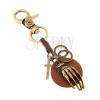 Patinált kulcstartó sárgaréz színben, körös bőrsáv kézzel, karika, kereszt