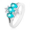 Fénylő gyűrű ezüst színben, kék színű ovális cirkóniák, átlátszó cirkóniák