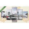 Képáruház.hu Ezüst BMW felhőkarcolókkal(135x70 cm, S01 Többrészes Vászonkép)