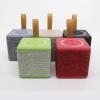 NewRixing kompakt bluetooth hangszóró dizájnos textil borítással - több színben